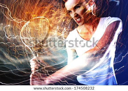 Woman playing tennis - backhand - stock photo