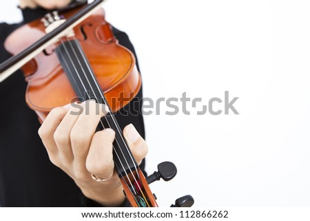 Woman playing violin on isolated white background - stock photo