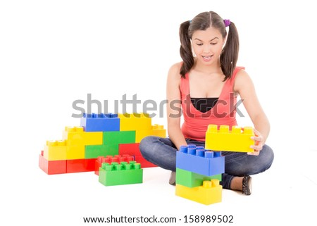 woman playing with blocks - stock photo
