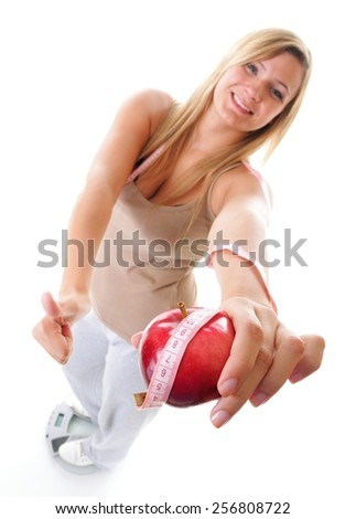 Woman plus size large happy girl on weight scale with apple measuring tape celebrating weightloss progress after diet, thumb up gesture. Healthy lifestyles concept - stock photo
