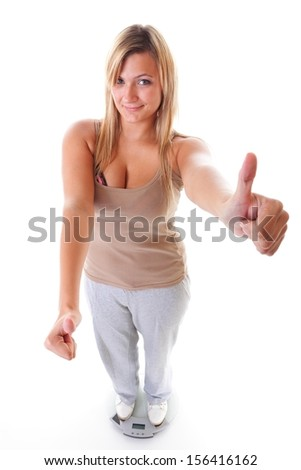 Woman plus size large happy girl with weight scale celebrating weightloss progress after diet, thumb up gesture, she lost some weight. Healthy lifestyles concept - stock photo