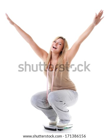 Woman plus size large happy girl with weight scale celebrating weightloss progress after diet, she lost some weight. Healthy lifestyles concept - stock photo