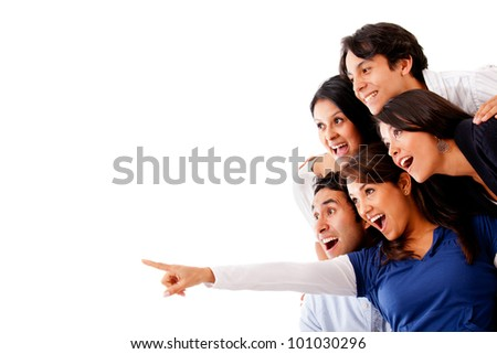 Woman pointing and a surprised group looking - isolated - stock photo