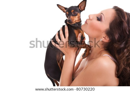 woman pointing at little dog, isolated on white background - stock photo
