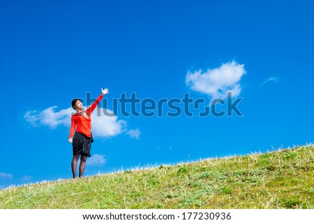 Woman pointing at the sky