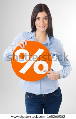 woman pointing to a orange board - stock photo