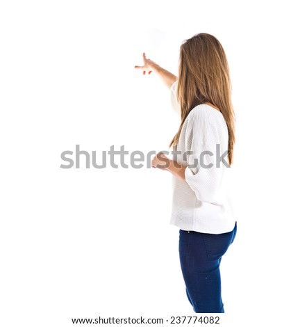 woman pointing to the lateral  - stock photo