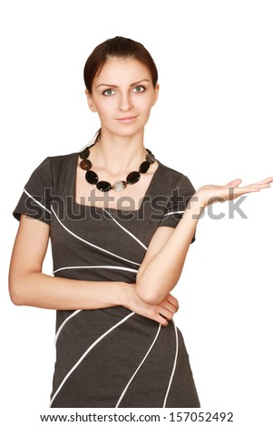 Woman pointing up at copy space over white background - stock photo