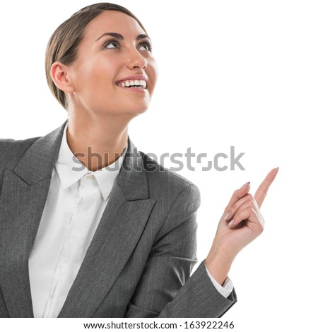 Woman pointing upwards having a business idea - isolated over a white background - stock photo