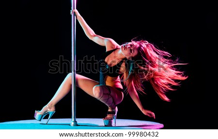 woman pole dancer performing act - stock photo