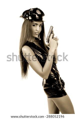 woman police officer with a gun in his hand on the isolated background  - stock photo