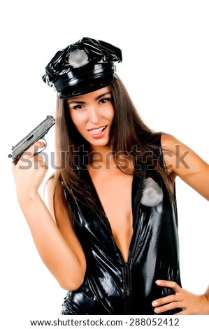 woman police officer with a gun in his hand on the isolated background