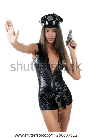 woman police officer with gun shows Stop Crime - stock photo