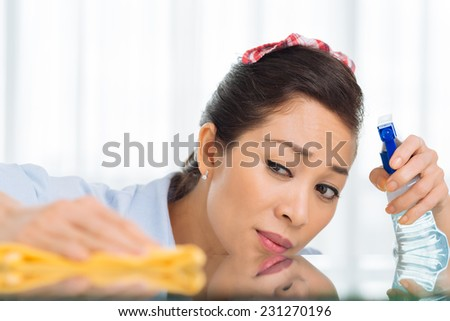Woman polishing the surface of the table - stock photo