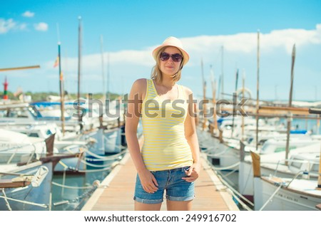 Woman portrait against of the pier with yachts. - stock photo
