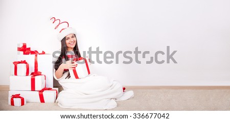 woman portrait hold christmas gift. Smiling happy girl on white background. - stock photo
