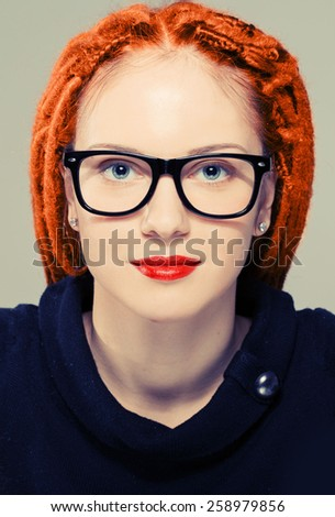 Woman portrait in glasses with dreadlocks red lips hipster - stock photo