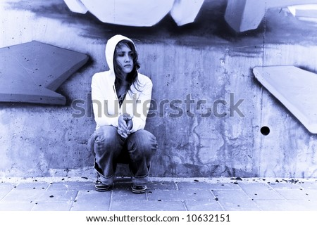 Woman portrait in urban background. Blue toned. - stock photo