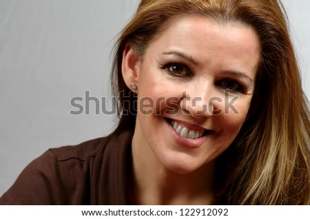woman portrait on gray background - stock photo