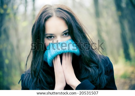 Woman portrait with big woollen collar for cold weather. - stock photo