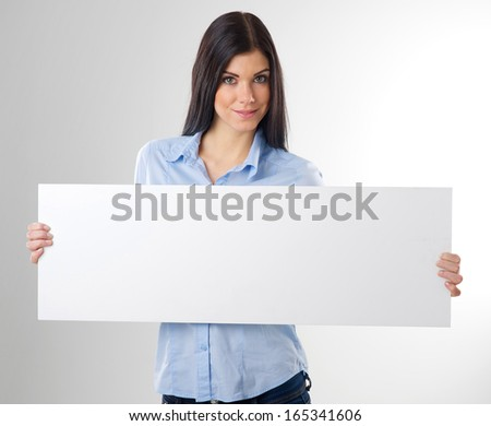 woman portrait with blank white board - stock photo