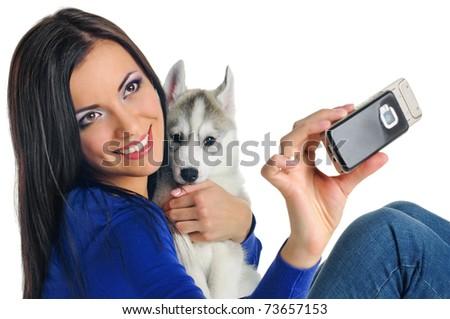 woman portrait with puppy of siberian haski on white - stock photo