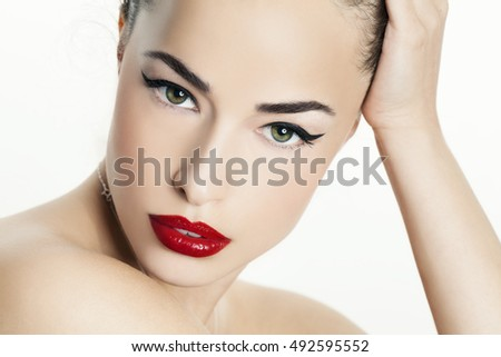 woman portrait with red lips and black eyeliner, beauty closeup
