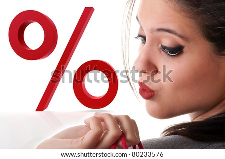 Woman portrait with shopper in her hand and a large percentage symbol on background - stock photo