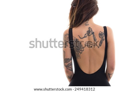 Woman portrait with tattoo against white background with copy space. - stock photo