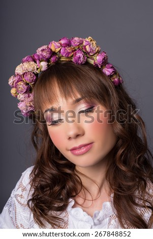 woman portrait with wreath of flowers studio shot - stock photo