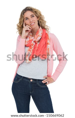 Woman posing and smiling while touching her head on white background - stock photo