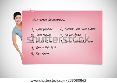Woman posing behind a list against pink card - stock photo