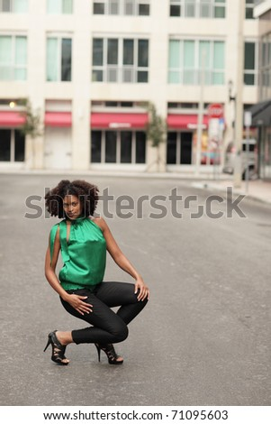 Woman posing in the middle of the road - stock photo