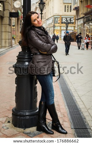 Woman posing near the pillar - stock photo