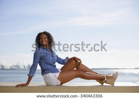 Woman posing on the ledge - stock photo