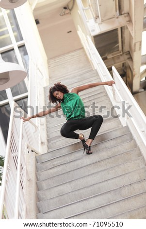 Woman posing on the staircase - stock photo