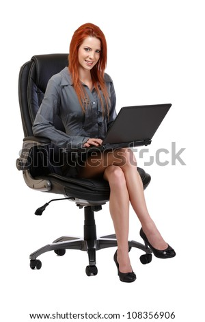 woman posing with laptop on chair, isolated on white - stock photo