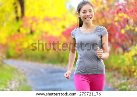 Woman power walking nordic speed walk and jogging and running lightly in forest in spring or summer. Sport fitness girl sports training and working out living healthy active lifestyle in forest. - stock photo