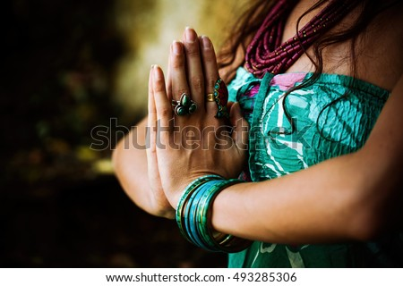 woman practice yoga outdoor close up of hands in namaste gesture