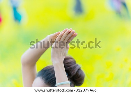 Woman practices yoga outdoors. - stock photo