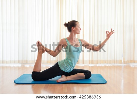 Woman practicing flexible yoga pose.  - stock photo