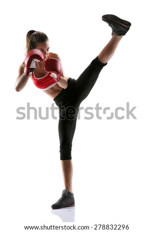 Woman practicing tae-bo exercises, kicking forward with legs / photo set of sporty muscular female brunette girl wearing sports clothes over white background - stock photo