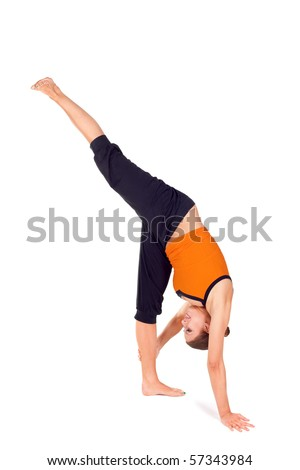 ... practicing yoga exercise called: standing split, sanskrit name: urdhva