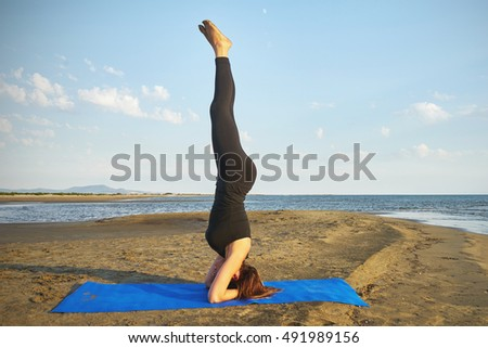 Woman practicing yoga in various poses (asana) by the sea