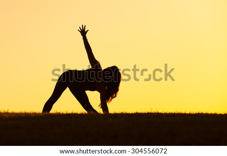 Woman practicing yoga outdoors.  - stock photo
