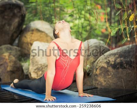Woman practicing yoga. Upward-Facing Dog. Urdhva mukha svanasana - stock photo
