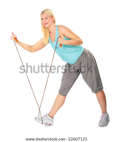 Woman practises with a skipping rope - stock photo