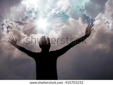 Woman praise the lord- Silhouette of a woman praising to God  - stock photo