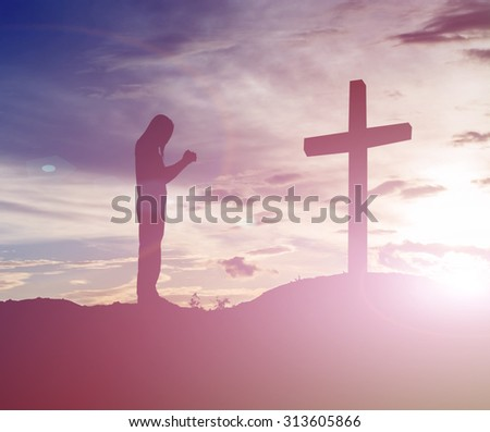 woman pray with cross silhouette, god concept