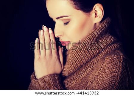 Woman praying - stock photo